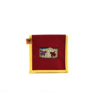 Piros kismadaras mobil töltő tartó